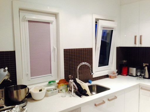 Small uPVC tilt-and-turn windows in the kitchen